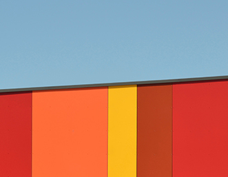 orange-red-striped-building-sky