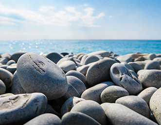 rock-beach-blue-sky-sea
