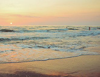 sunset-beach-sea-swimmers