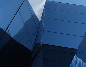 blue-glass-building-geometric-shapes