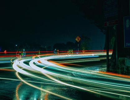 blurred-green-car-lights-night