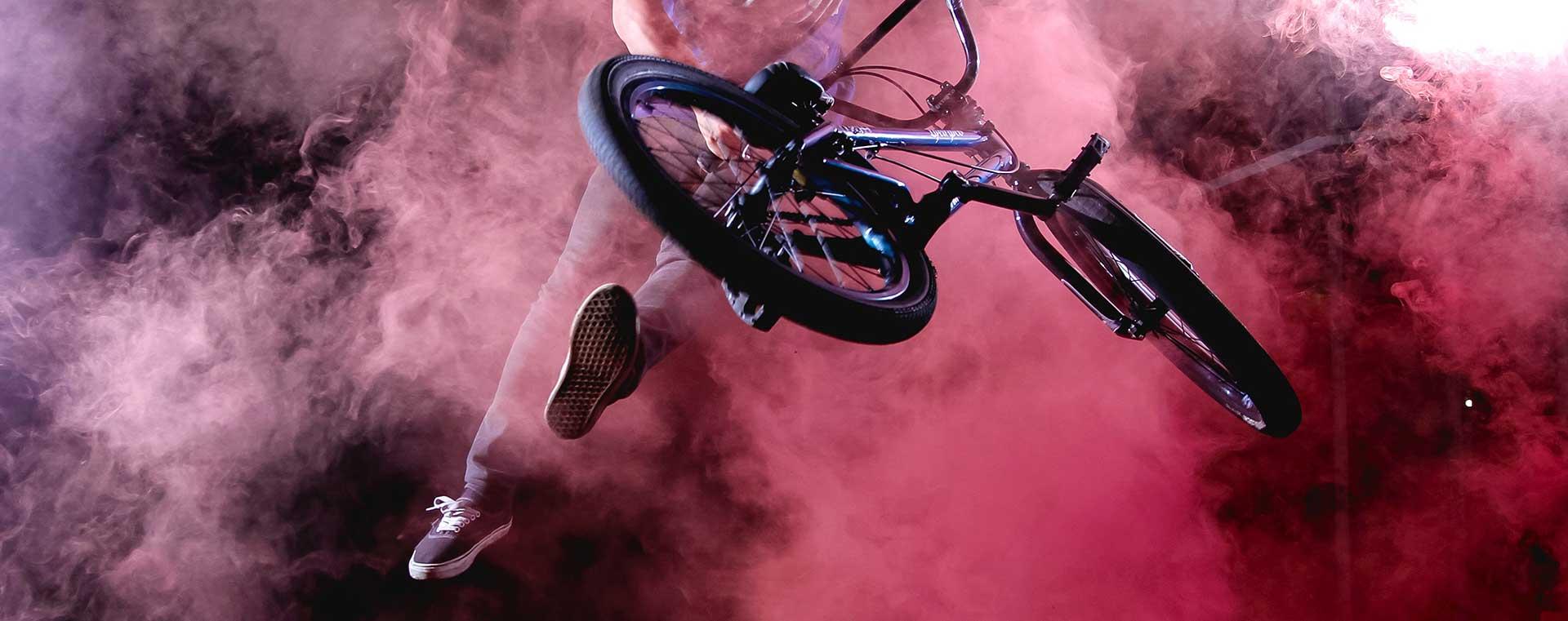 bmx-biker-jumping-flip-pink-smoke
