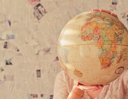girl-holding-globe