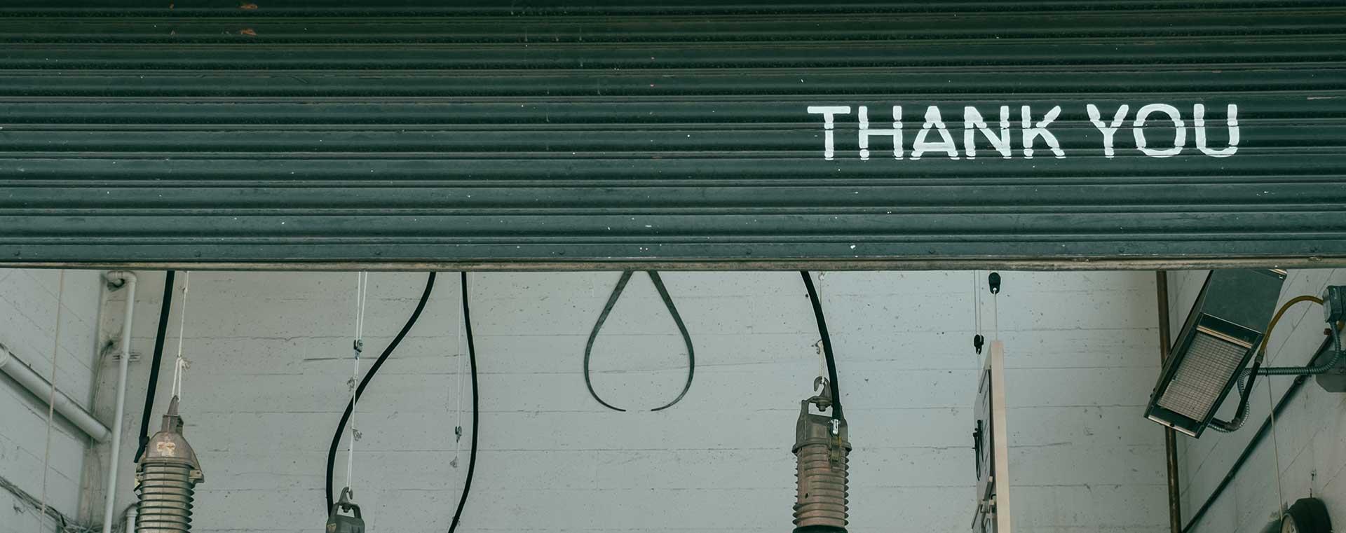 green-shutters-lights-thank-you-writing