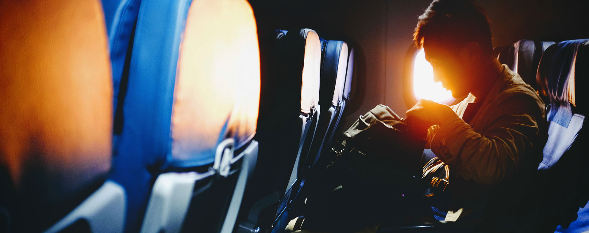 man-sitting-plane-sunrise