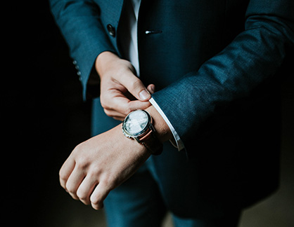 man-suit-wearing-watch