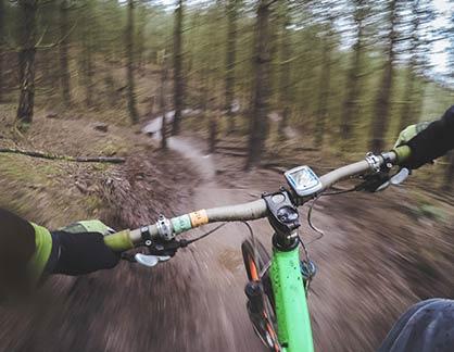 mountain-biking-through-wood