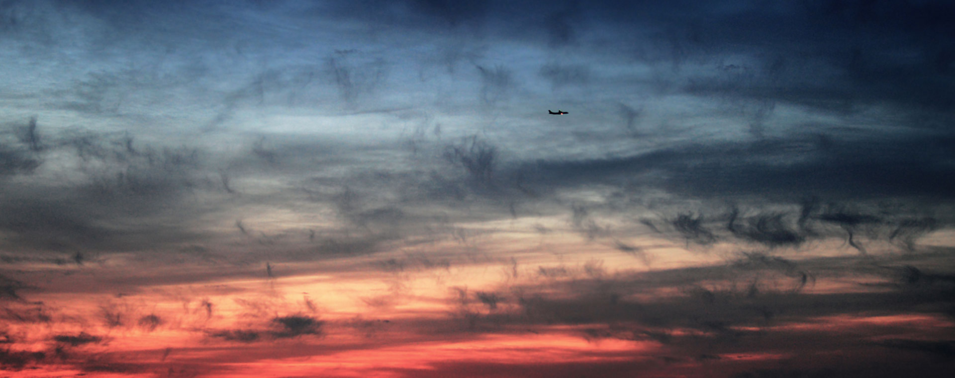 plane-blue-red-sky-clouds