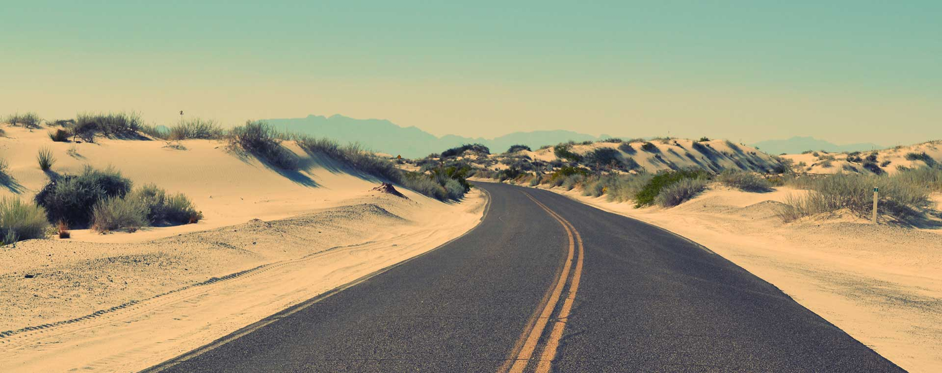 road-sand-dunes-blue-sky