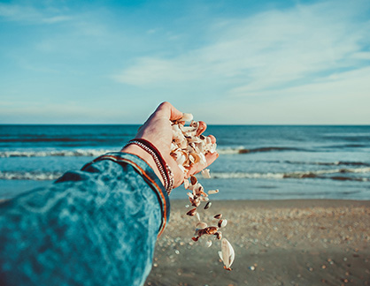 holding-sea-shells-beach