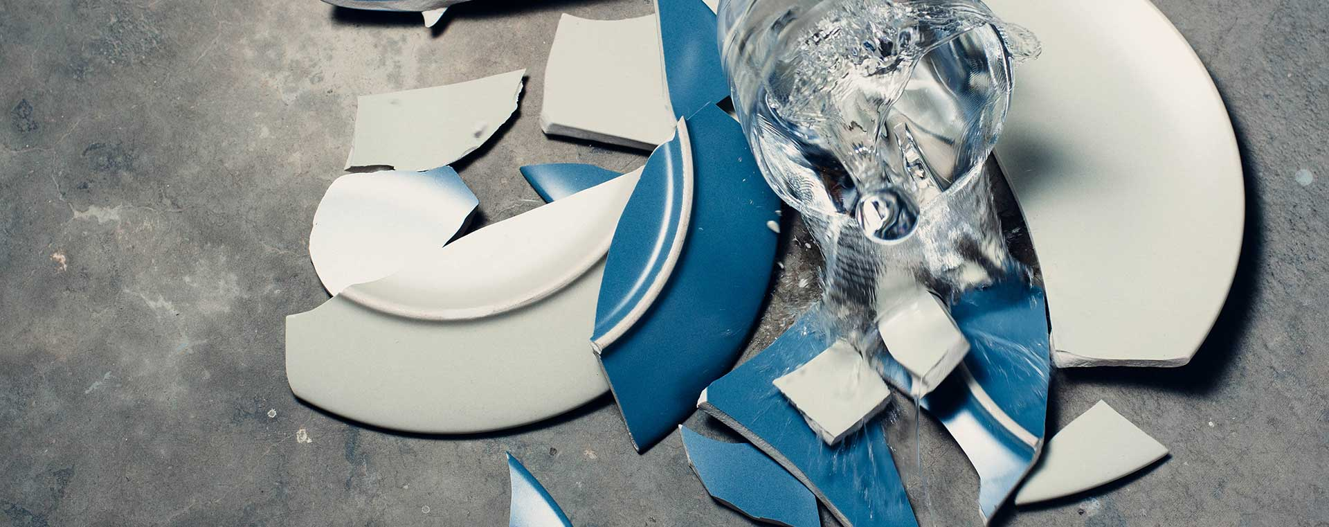 smashed-blue-plates-glass-water-concrete
