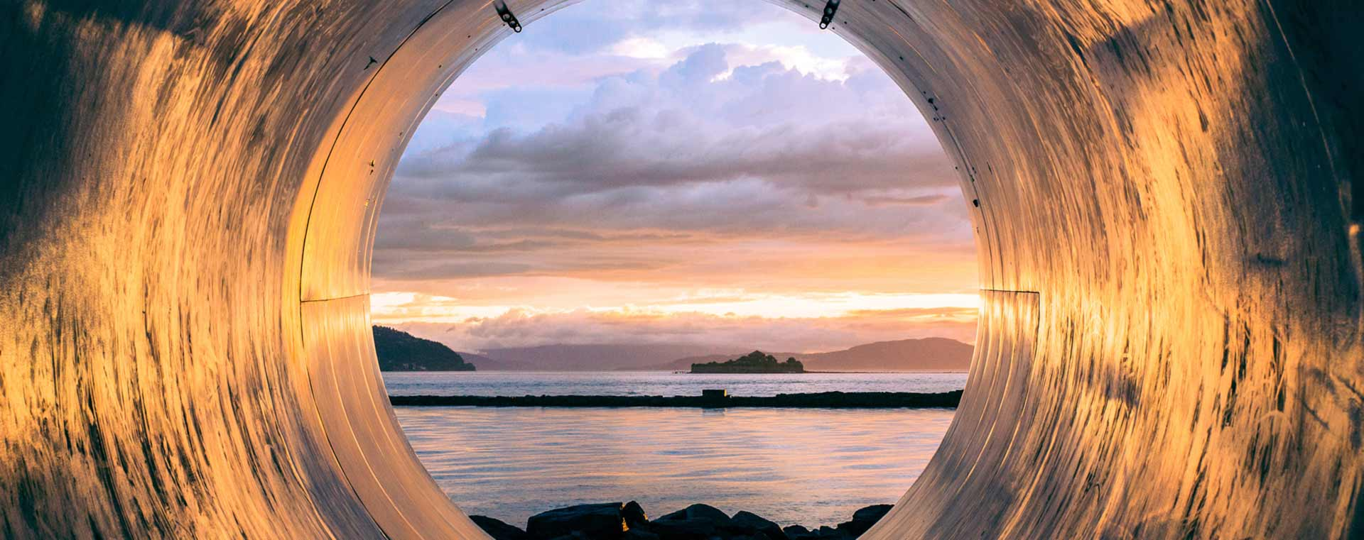 sunset-sea-through-tunnel-hole